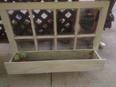 Transformed an old vintage wooden window into a planter box