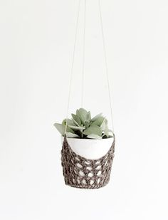 DIY Crochet Hanging Planter - Back again today with another post that I did not make… hahah! But I did ask my cousin to make it and took the photos so that counts for something! A couple weeks ago, I shared this knit plan…: