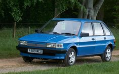 in blue. Creative Commons Photos, Tv Adverts, Used Toyota, The Austin, Best Positions, Ford Escort, Back In The Day, Old Cars, 1990s