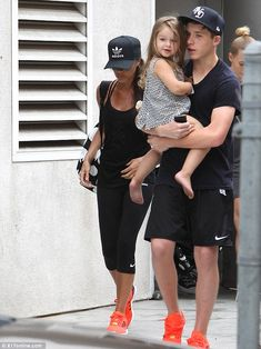 Not joining in: While Brooklyn and Victoria wore matching trainers - Harper went without a pair