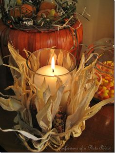 Fall Candle hot glue mini Indian cor to glass vase.  Fold corn husks up and tie with twine or raffia. Great idea for a centerpiece. Supplies available at Pat Catan's Craft Centers, Ohio