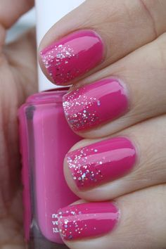 Bright pink nails with glitter ombre accents from grape fizz nails