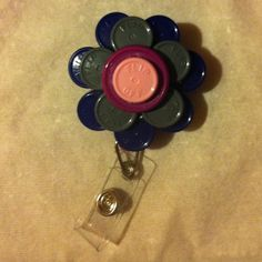Retractable name badge holder made with vile caps!!! Fun, free, and easy!!!