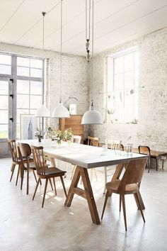 This is the coolest #dining #room - #double #volume #ceilings #rustic #urban #whitewashed #brick #walls..