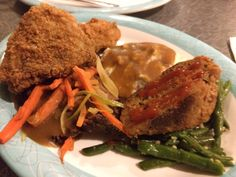50s Prime Time Cafe - Hollywood Studios. A sampling of Mom's favorite recipes - Crispy fried chicken, fork tender pot roast and traditional meatloaf with all the fixins.