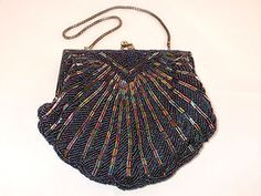 An vintage inspired black sequined oyster shaped handbag. You can find these on ebay or at www.weddingo.co.uk Oysters, Bucket Bag, Vintage Inspired, Shapes, Bags, Inspiration, Fashion, Handbags, Biblical Inspiration