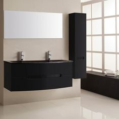 Superbe ensemble de salle de bain avec un meuble de salle de bain noir avec une vasque noire, une colonne et un miroir. Cet ensemble allie sobriété et modernité. Decor, Furniture, Bathroom Lighting, Lighted Bathroom Mirror, Home Decor, Bathroom Mirror, Bathroom, Light, Mirror