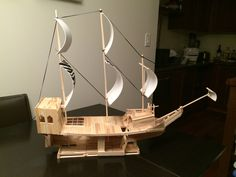 Angle #2 -  Pirate ship made out of popsicle sticks, wooden dowels and some foam! Does not float on water but the bottom half is exposed to allow figurines to play under the deck. Hours of fun for kids.