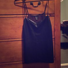 Leather tanktop Black faux leather tank top with see through back. Adjustable straps. Forever 21 Tops Tank Tops