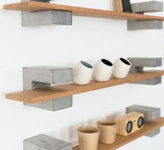 Wood & Concrete Shelf by Sue Pryke; a British Homeware designer. They have a brutalist element with the chunky concrete brackets contrasting against the smooth Oak shelves. Wood Concrete, Concrete Furniture, Concrete Crafts, Concrete Projects, Concrete Design, Diy Furniture, Furniture Design, Polished Concrete, Oak Shelves