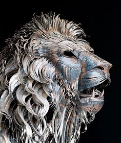 Turkish artist Selcuk Yilmaz created this unbelievable lion sculpture from 4,000 pieces of hammered metal. Entitled Aslan, the sculpture took the artist 10 months to complete and weighs approximately 250 kg (551 pounds). The sculpture measures 330 cm long by 185 cm tall (10.8 ft x 6.06 ft)  Every piece of metal used was hand cut and hammered by the artist.