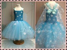 Elsa Snowflakes Tutu Dress.   Frozen Tutu Dress. Elsa Tutu Dress. Beautiful & lovingly handmade.   Price varies on size, starting from £25.  Please message us for more info.   Find us on Facebook www.facebook.com/DiddyDarlings1 or our website www.diddydarlings.co.uk