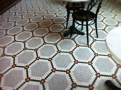 Hexagonal mosaic tile floor. Would be fantastic in a bathroom as well as restaurant.