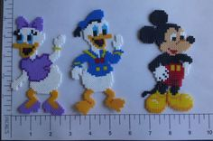This is a made to order set of Mickey Mouse Clubhouse magnets. These are made using smaller Hama Beads and take 2-3 days to complete. Each set comes with seven magnets, Mickey, Minnie, Donald, Daisy, Goofy, Pluto and Toodles, Magnets are not intended for children under 3. Magnets are NOT toys and are harmful or fatal if swallowed. Every care is taken to insure magnets are completely adhered using industrial adhesive and a 24 hour curing process. Fuse bead art is made by arranging beads in a…