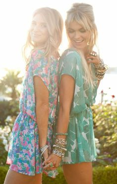 We are excited to go to the beach today, and we both are wearing our pretty patterned dresses......