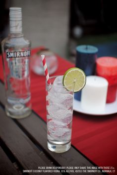 Smirnoff Coconut and Seltzer drink recipe with 1.5 Smirnoff Coconut Flavored Vodka and 3 oz Seltzer. Build in a tall glass, stir and garnish with a lime wedge. #Smirnoff #drink #recipe #coconut #July4 #FourthofJuly