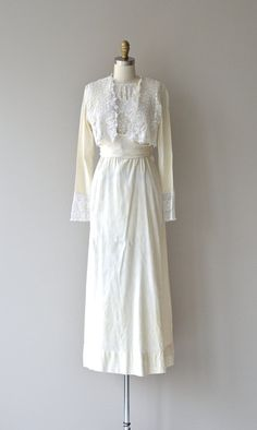 Antique 1910s Edwardian wedding dress with creamy ivory textured cotton and white cotton lace, long sleeves, wrapped waist, and side hook and eye and