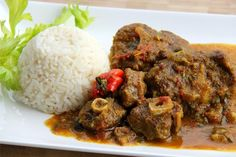 Oxtails braised in a rich Caribbean Caribbean curry sauce. Click for the recipe with full video tutorial.