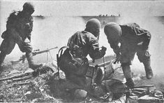 Imperial Japanese Army paratrooper are accessing their cargo container to get out type 99 light machine guns, rifles and grenade launchers during the battle of Palembang, February 13, 1942.
