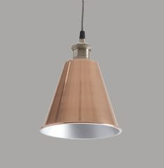 Reginald Pendant Light.*Only 2 left! This elegant metal pendant light is a classic design and perfect for all interiors and spaces. It has a vintage metal fitting and copper plated shade that's silver inside for a cool, soft light. It looks great lit or unlit. It comes with approximately 100cm of traditional black and white flex that can be shortened to any length and matching ceiling rose, as shown. Ideal in kitchens, dining rooms, hallways or living rooms, they look great on their own and…