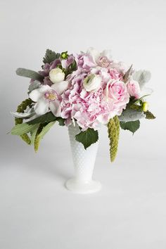 Romantic pink and white floral arrangement using a combination of orchids, hydrengea, roses, lambs ear and greenery presented in a glass vase. From Urban Orchid via @BloompopHQ