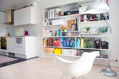 All white walls and shelves, color comes from the accessories