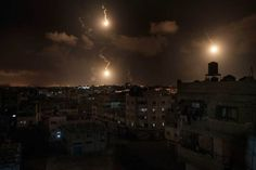 Israeli army flares illuminate the sky above the Gaza Strip, July 2014 Night On Earth, Gaza Strip, Crossfire, Holy Land, Night Time, In The Heights, Illusions, Beautiful Pictures, Army