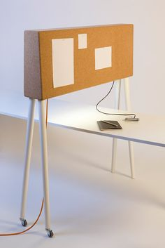 GIRAFFE is a portable spatial divider. It creates a visual enclosure for those who are sitting behind it but does not interfere in the general openness of a room. It is also a pin board and a hub for wired connections (Ethernet, electrical).