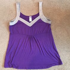 Purple tank top with silver straps. Size L This a new tank top and it has a slightly loose fit. Perfect for summer or spring. Covington Tops Camisoles