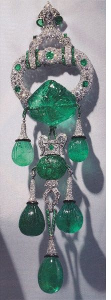 Royalty & their Jewelry - Shoulder brooch owned by Majorie Merriweather . Eight inches long, set in platinum. 250 carats of carved Indian emeralds from the 17th Mughal period. Set by Cartier New York, 1928