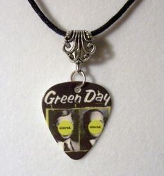 "GREEN DAY Necklace - ""Nimrod / Good Riddance"" Guitar Pick Necklace. $9.50, via Etsy."