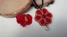 Check out this item in my Etsy shop https://www.etsy.com/listing/537187488/red-flower-necklace-paper-jewelry