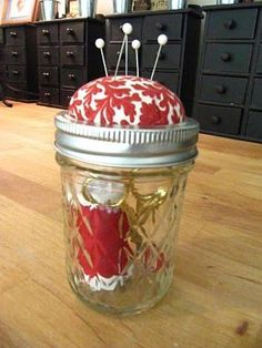 Tutorial for making a pin cushion atop of a canning jar.  Perfect for xstitch leftover threads with a place to stick needle on top