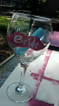 I painted mustaches on a wine glass with chalk board paint for my bridal shower.