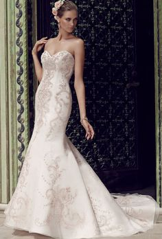 Brides: Casablanca Bridal. Fit and flare silhouette gown with a strapless sweetheart neckline features exquisite beadwork and embroidery on tulle, over organza with a sleek satin lining. The V back satin neckline is accented with a sheer tulle neckline encrusted with matching beading and embroidery.