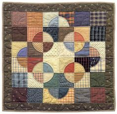 "Geometric traditional, with homey plaids. From ""Quilts from Aunt Amy."""