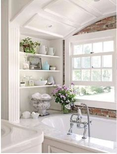built in shelves, exposed brick wall, arched ceiling