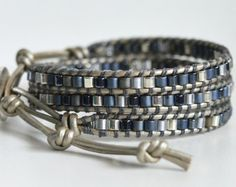 This beautiful bracelet showcases Japanese high quality Miyuki picasso red 6/0 seed beads. They are stitched securely to 1.5mm natural grey-brown leather with 2 strands of sturdy nylon beading thread.  The bracelet will wrap 3 times around a wrist and has 3 button loop closures which offer ample size adjustability. It measures 20 to the first button loop closure; 21 to the second; 22 to the third loop. A small oval stainless steel button finishes off the bracelet with nice accent.  If you…
