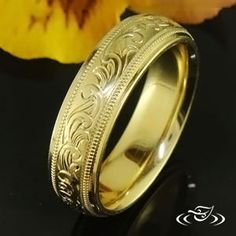 ENGRAVED BAND ~ 6mm comfort fit band with a 4mm engraved center with scroll pattern bordered by milgrain with 1mm flat rails with a polish finish.