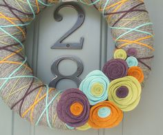 Hey, I found this really awesome Etsy listing at http://www.etsy.com/listing/99833384/yarn-wreath-felt-handmade-door
