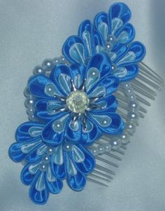 This silver plated hair comb is made from satin ribbons,decorated with glass pearl beads and a clear faceted bead in the middle.  Comb size-8 cm X 3.5 cm  Flower size-11.5 cm X 5.5 cm  Thank you for taking time to have a look !