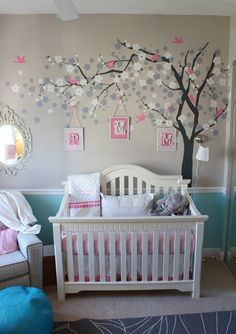 Grey and pink color scheme; pics hanging from tree mural; chair rail with dual wall color