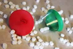 Marshmallow shooters from a balloon and plastic cup (could also be used to shoot cotton balls or other soft things)