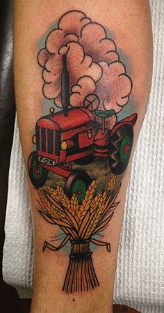 Tractor tattoo - if I ever get a tattoo in honor of my dad, something like this just might be it.