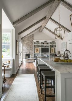 Love The Beams. Vaulted Ceilings, Marble Surfaces And Crisp White  Cabinetry, This Contemporary Kitchen Remodeled By Julie Bradshaw Seems  Light And Airy. Part 65