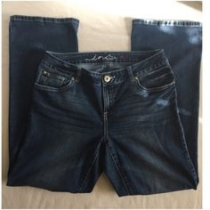 """INC boot cut curvy jeans 10S INC jeans with flap pockets. Slightly lighter in color than picture shows. These are boot cut, curvy style. Not a slim fit and has some stretch. 10 short. 55% cotton, 22% polyester, 22% rayon and 1% spandex. 29"""" inseam INC International Concepts Pants Boot Cut & Flare"""