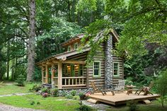 Beautiful color combo. Green for trim is perfect with this color on a log sided cabin. Pretty setting too.