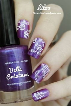 Cool purple nails using nail stamps.