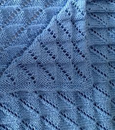 "Free Knitting Pattern for Easy Reversible Nickerchen Baby Blanket - This easy lace blanket is named after the German word for ""nap"" and is completely reversible. Designed by Mirella Lilli. Rated easy by Ravelrers. Available in English and Italian. Pictured project by moniquelachance"