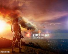 Caucasian soldier overlooking combat zone